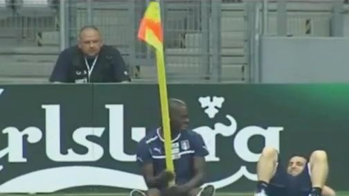 Mario Balotelli plays with a corner flag during training while with Italy at Euro 2012
