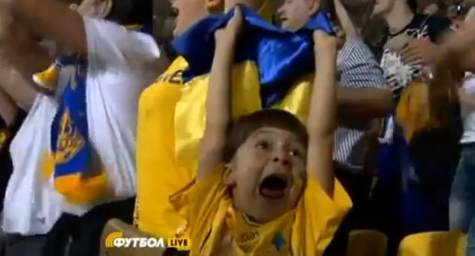 Young Ukrainian fan celebrates Andriy Shevchenko's goal against Sweden