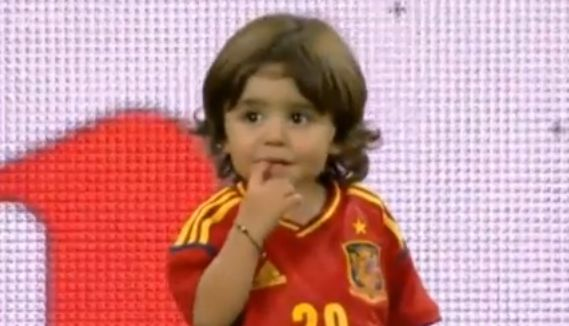Xavi's son looks cute for the cameras after Spain beat Italy in the final of Euro 2012