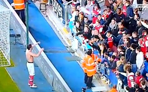 Arsenal's Olivier Giroud and Francis Coquelin retrieve their shirts from the crowd before the start of extra time