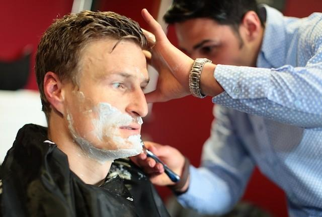 Robert Huth gets a clean shave in preparation for his Movember effort