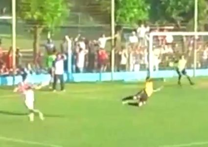 A San Martín substitute runs on to the pitch to save an almost certain goal against Bell Ville