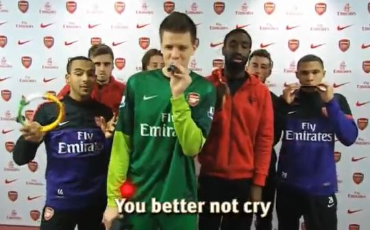 The Arsenal players sing Christmas chants for a Junior Gunners competition