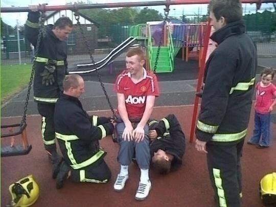 The Fire Brigade rescue a Manchester United fan stuck in a child's swing
