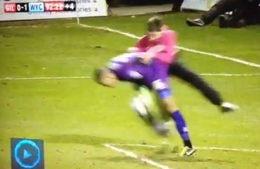 A Gillingham fan attacks Wycombe goalkeeper Jordan Archer, on loan from Spurs