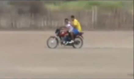 A goalkeeper uses a moped to get back in goal after going forward for a corner kick