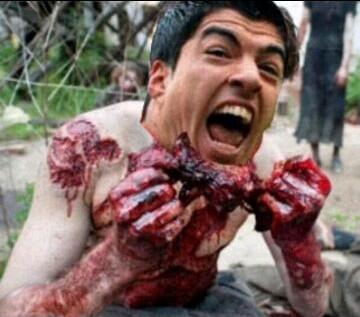 Luis Suárez after biting Branislav Ivanović - #PlayersOnTheSuarezMenu suggests other players he might like to eat