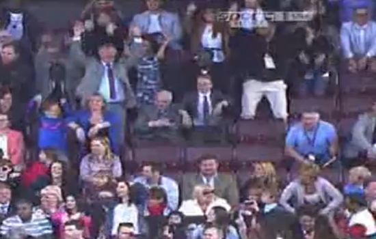 Sir Alex Ferguson does the Mexican wave at Old Trafford during a legends match between Manchester United and Real Madrid