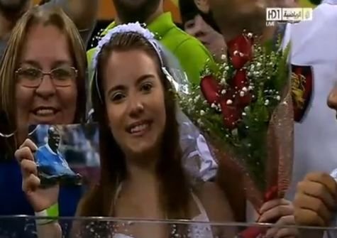 Girl in wedding dress proposes to Balotelli during Italy v Japan