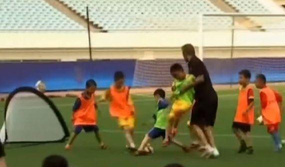 David Beckham cheats to beat Chinese kids at football