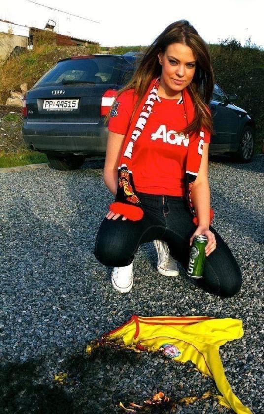 Photo Female Manchester United Fan Burns Liverpool Shirt