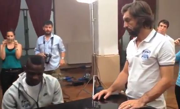 Mario Balotelli plays piano while Andrea Pirlo watches
