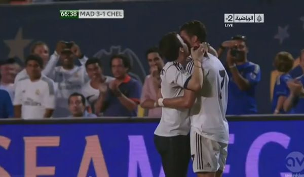 Fan hugs Ronaldo during Real Madrid v Chelsea friendly
