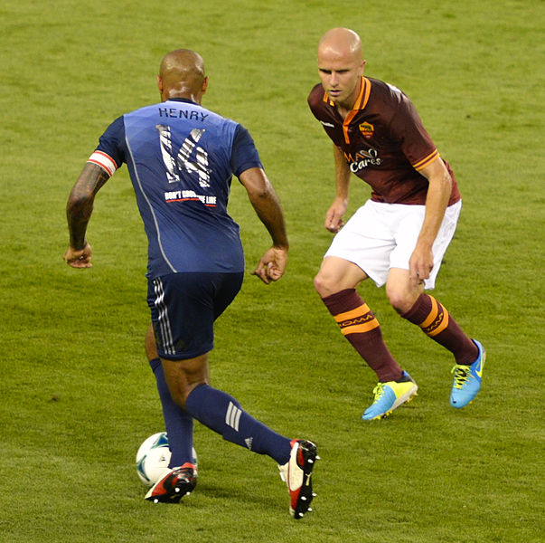 Michael Bradley scores for Roma against Udinese, but not in this photo - here he faces Henry while playing against the MLS All Stars