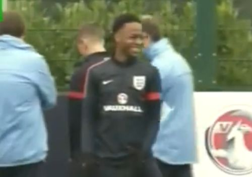 Jack Wilshere takes a piss during an England training session