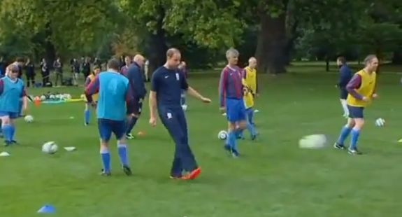 Prince William plays football while hosting a match at Buckingham Palace