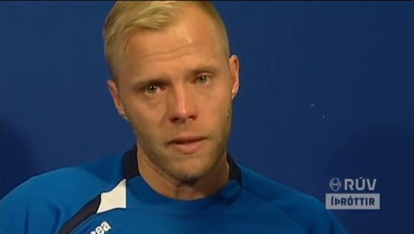 Eidur Gudjohnsen cries as he announces his retirement from international football after Iceland fail to reach World Cup 2014