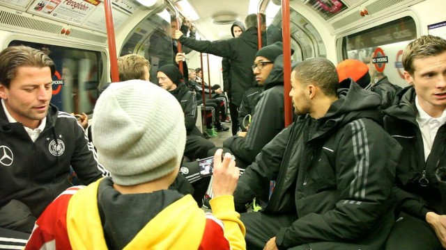 A fan takes a picture as Germany take the tube to Wembley ahead of friendly with England