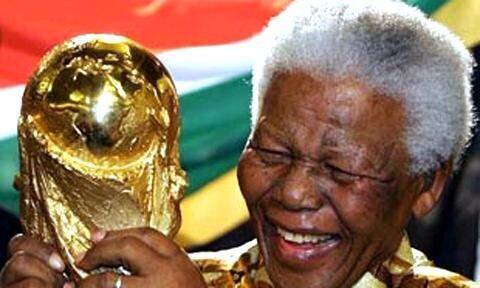 Football tributes to Nelson Mandela, pictured here with the World Cup in South Africa
