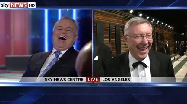 Sir Alex Ferguson at the Oscars shares a joke with Eamonn Holmes