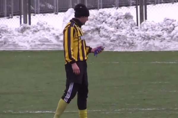 A Ukrainian player answers his phone during a match