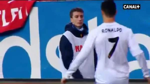 An Atlético Madrid ballboy defies Cristiano Ronaldo and throws the ball away from him in the Madrid derby