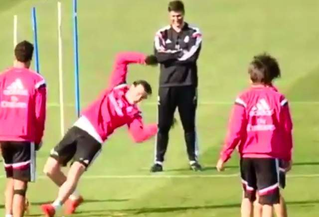 Real Madrid's Gareth Bale slips on a ball in training session