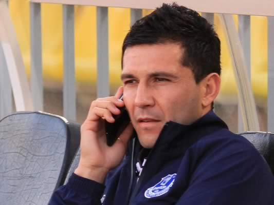 The Everton defender who suffered in their 5-2 Europa League last-16 second leg clash with Dynamo Kiev looks like he's checking out the Antolín Alcaraz jokes on Twitter