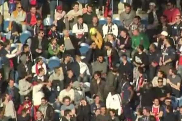 PSG fans throw ball around crowd and refuse to give it back during a match against RC Lens