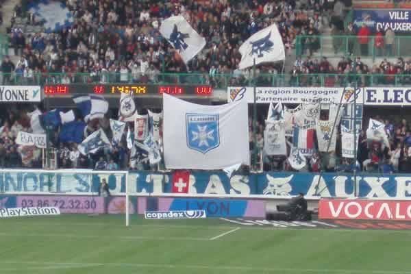 Auxerre fans invaded the pitch too soon at the end of their French Cup semi-final win against Guingamp and brought their big flags (seen here)
