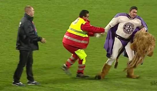 Austria Vienna's mascot is drunk and tries to escape from the match officials after his pitch invasion