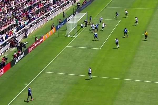 Ireland women's player kicks ball in face of teammate standing on the goalline as they defended a corner against USA