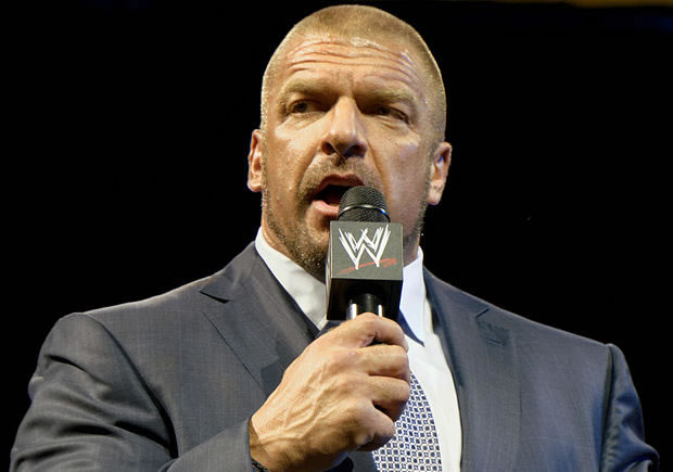 WWE's Triple H is a West Ham fan and thinks Andy Carroll could be a wrestler