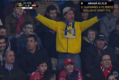 An Estoril fan celebrates their only goal against Benfica on his own