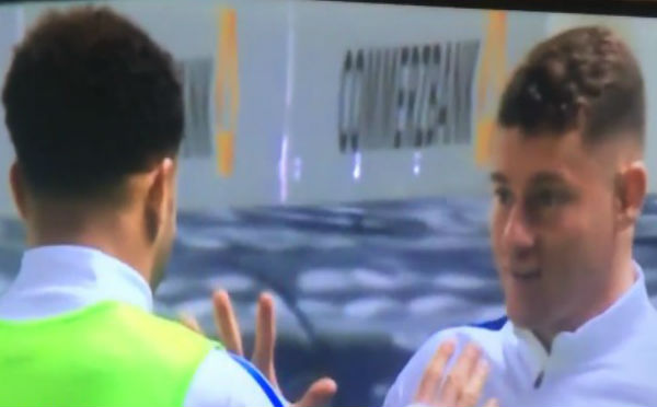 Kyle Walker and Ross Barkley play rock-paper-scissors at half-time of Germany 2-3 England
