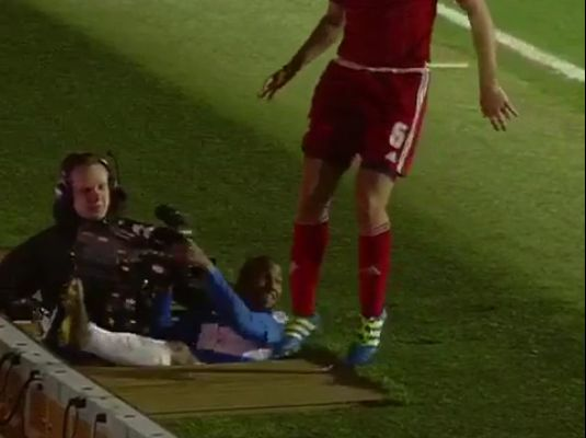 Junior Hoilett slides into a cameraman's pit during QPR's 2-3 defeat to Middlesbrough
