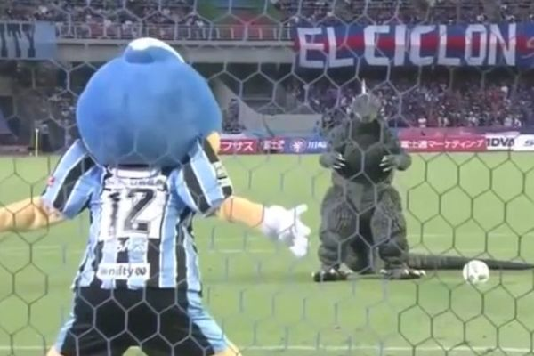 Godzilla takes a penalty before a match in Japan between Kawasaki Frontale and FC Tokyo