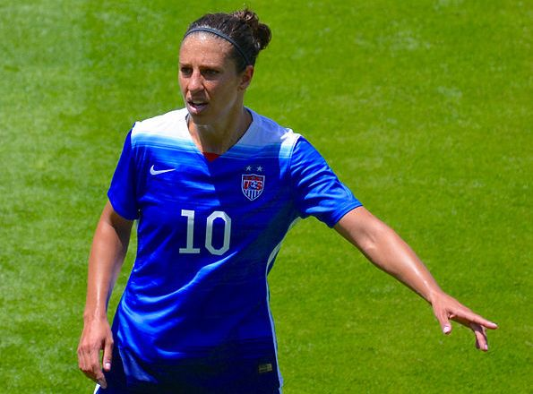 Carli Lloyd pointing to the information about Football Burp