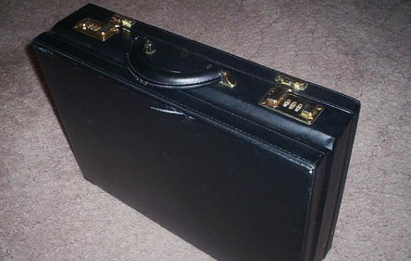 This briefcase might contain a bribe for a corrupt manager