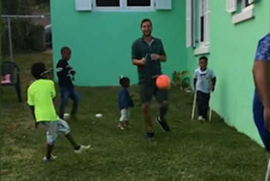 Child hits photographer in groin with football in garden at children's birthday party in Bermuda