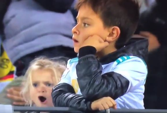 A young girl replicates Cristiano Ronaldo's goal celebration in the crowd at Dortmund for a Champions League tie