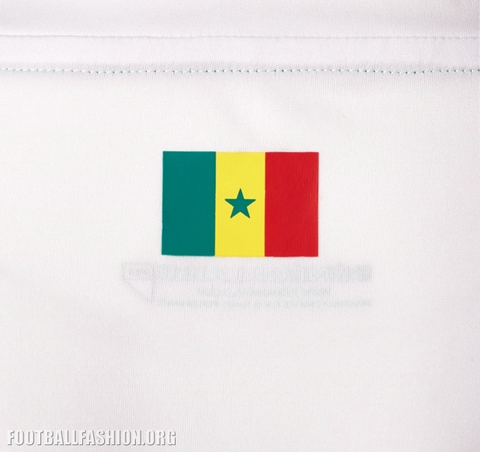 c331a2ed2e5 The alternate jersey is a bit more eye-catching thanks to a print of a  roaring like in Senegal's national color on its front right.