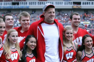 Jan 1, 2015; Tampa, FL, USA; Houston Texans defensive end J.J. Watt  posses for a picture with the Wisconsin Badgers cheerleaders prior to the game in the 2015 Outback Bowl against the Auburn Tigers at Raymond James Stadium. Mandatory Credit: Kim Klement-USA TODAY Sports