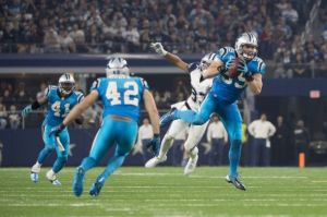 Luke Kuechly intercepting Tony Romo.