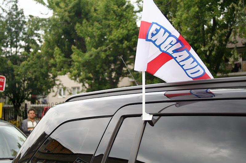 England: Hope, heartache and flags on car windows