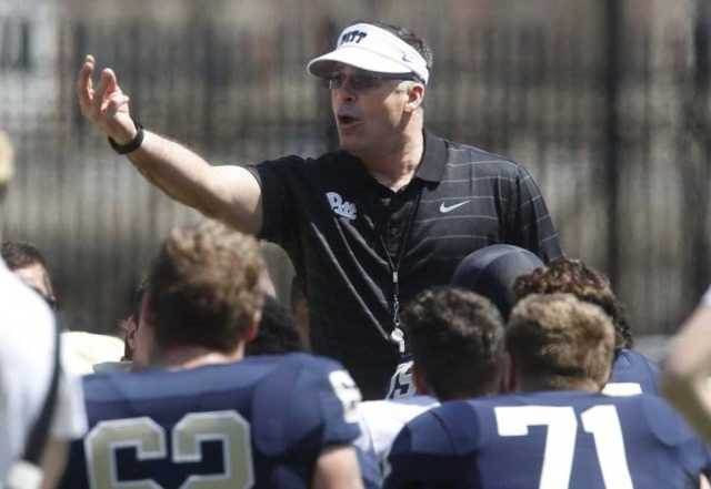 First year Pittsburgh head football coach Pat Narduzzi, center, talks with the team before their NCAA college Blue Gold spring football game, Saturday, April 18, 2015, in Pittsburgh. (AP Photo/Keith Srakocic)
