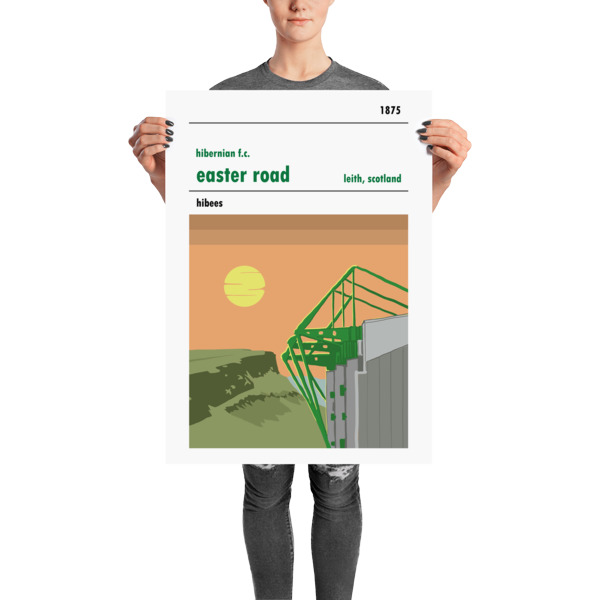 A stadium print of Easter Road, home of Hibernian FC, being held up by a woman