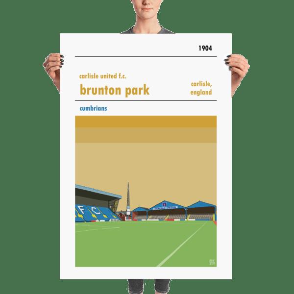 A huge football poster of Carlisle United and Brunton Park