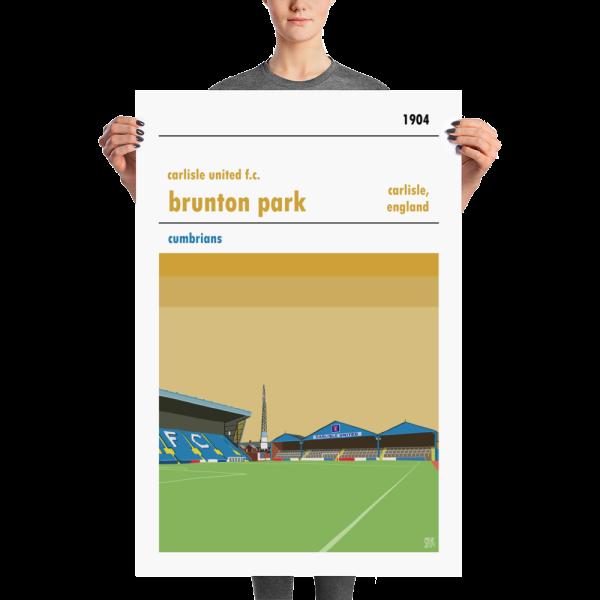 A large football stadium poster of Carlisle United and Brunton Park