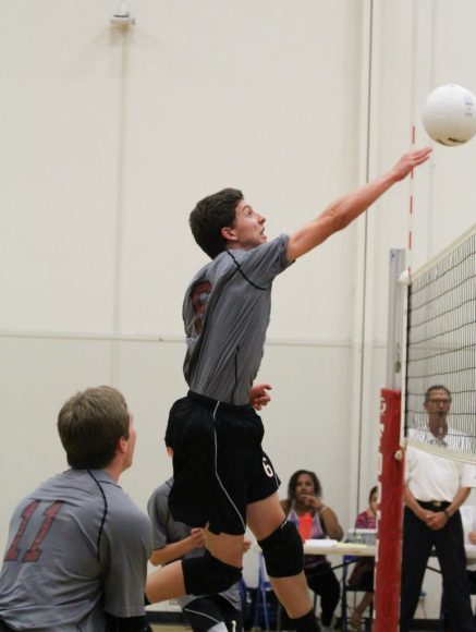 Freshman Stefan Fahr spikes the ball during Foothill's win against Hueneme. Credit: Sarah Fahr/The Foothill Dragon Press
